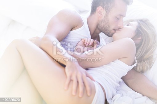 istock Man and woman kissing 490226020