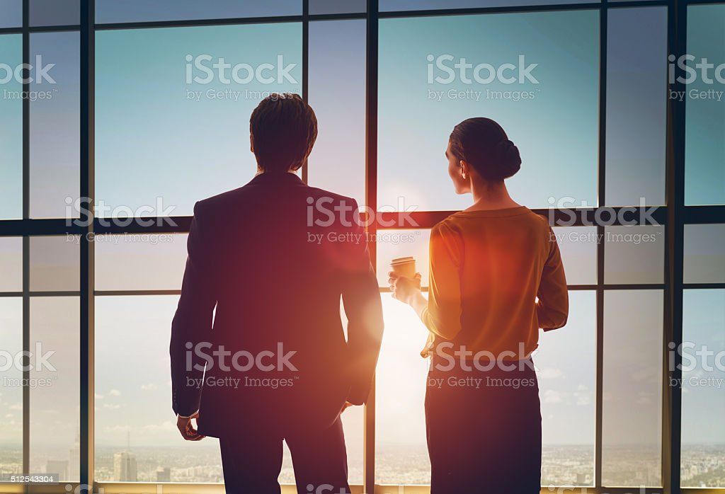 man and woman look at the city stock photo