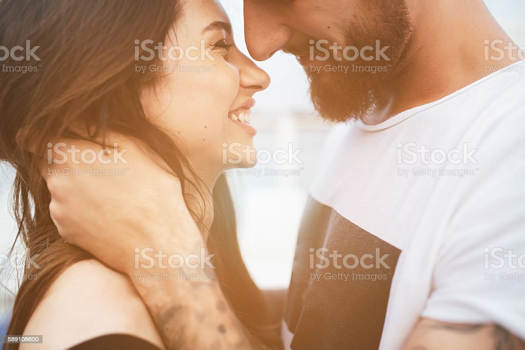 man and woman looking at each other stock photo