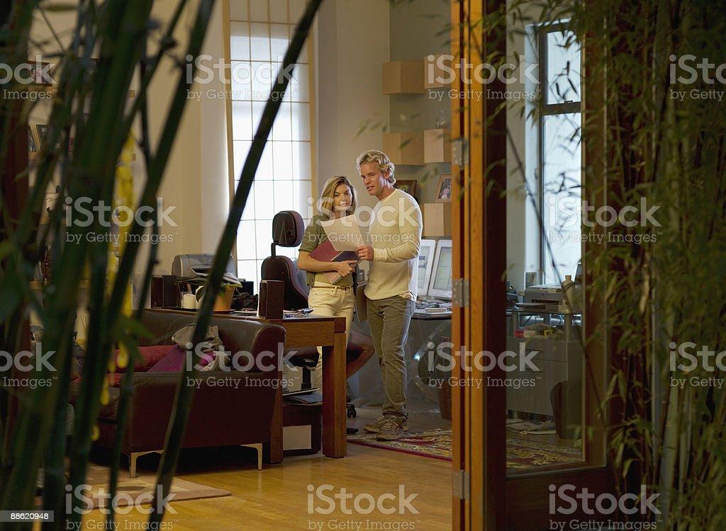 Man and woman looking at paperwork royalty-free stock photo