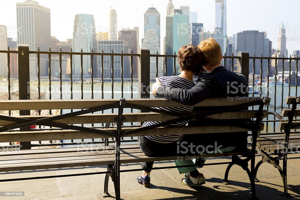Man and woman looking at skyline of Manhattan stock photo
