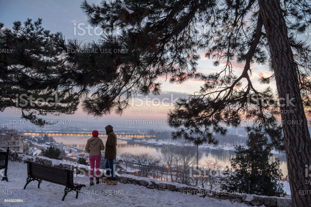 Belgrade, Serbia - January 1, 2015: man and woman looking at the panorama of Belgrade at dusk from Kalemegdan fortress'n'n stock photo