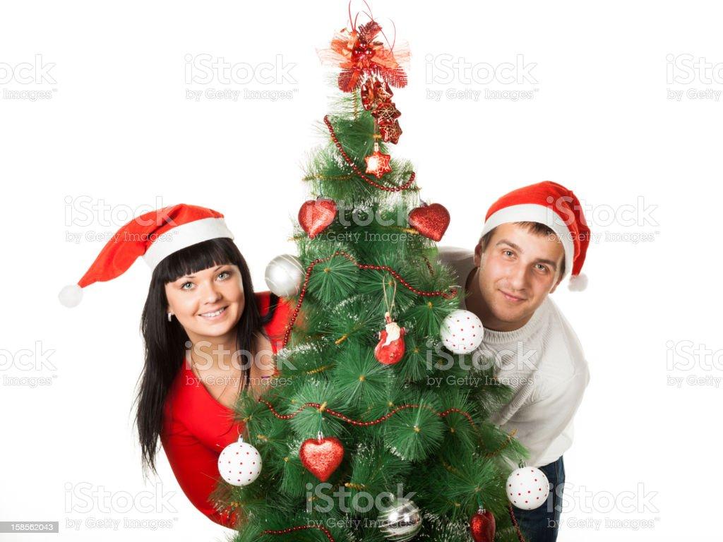 남자, 여자 루킹/크리스마스 트리 royalty-free 스톡 사진