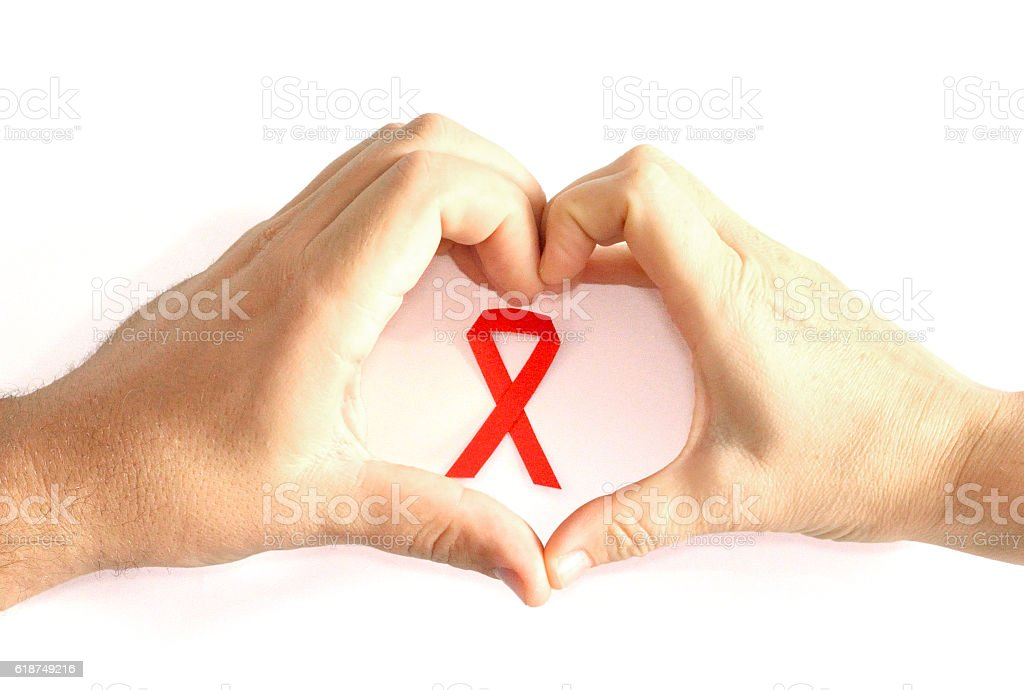 Man and Woman Making Heart Shape with Aids Awareness Ribbon stock photo