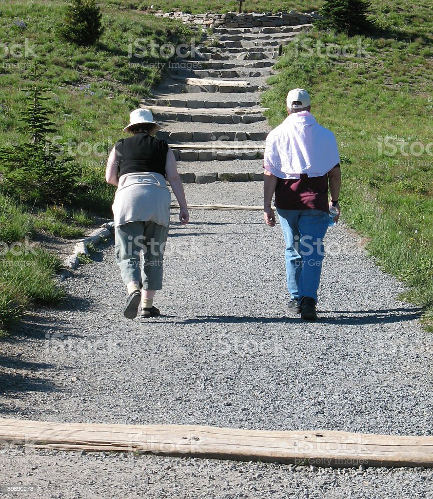 Man and woman on a hike royalty-free stock photo