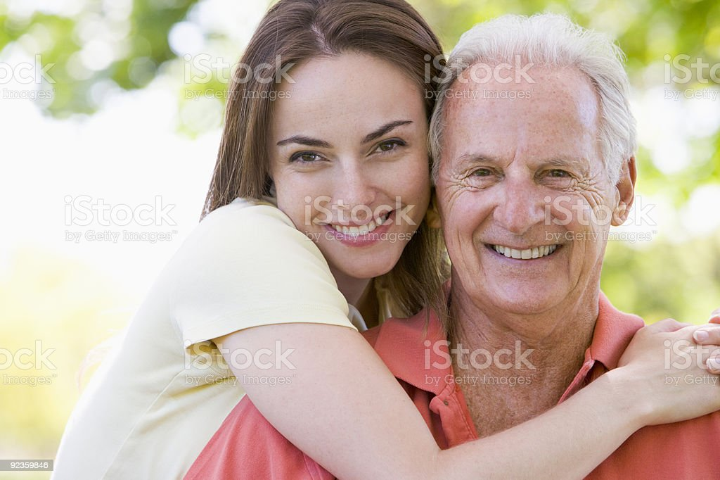 Man and woman outdoors embracing stock photo