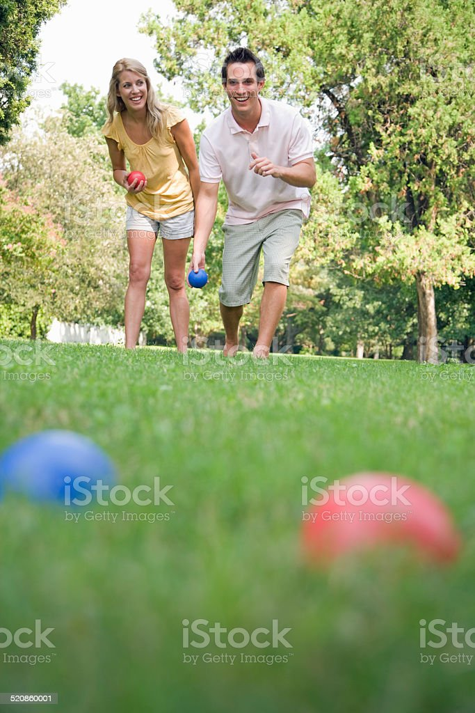Man and Woman Outside Playing Bocce Ball stock photo