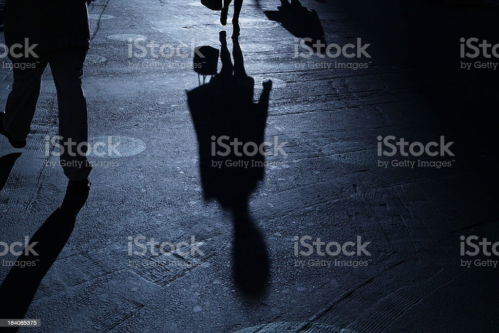 Man and woman passing in blue night shadows stock photo