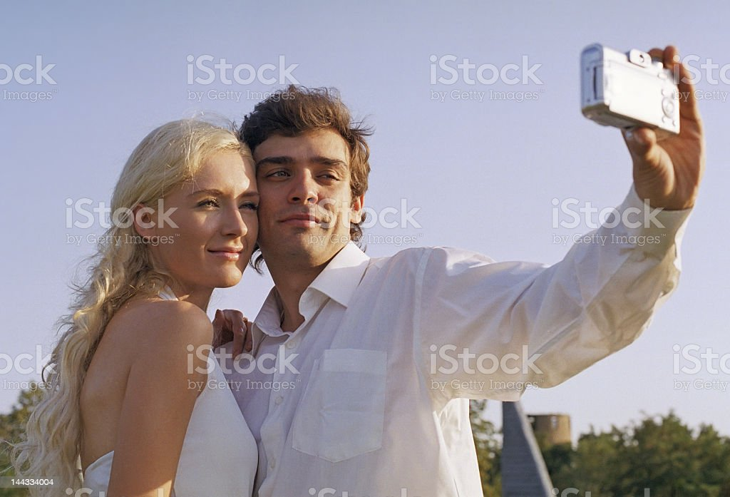 man and woman photograph yourselves royalty-free stock photo