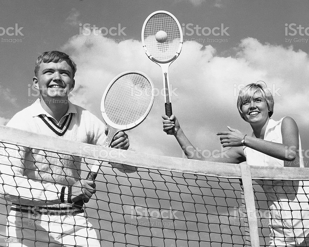 Man and woman playing tennis 免版稅 stock photo