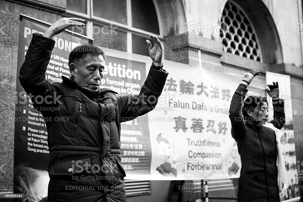 Man and woman practice Falun Dafa stock photo
