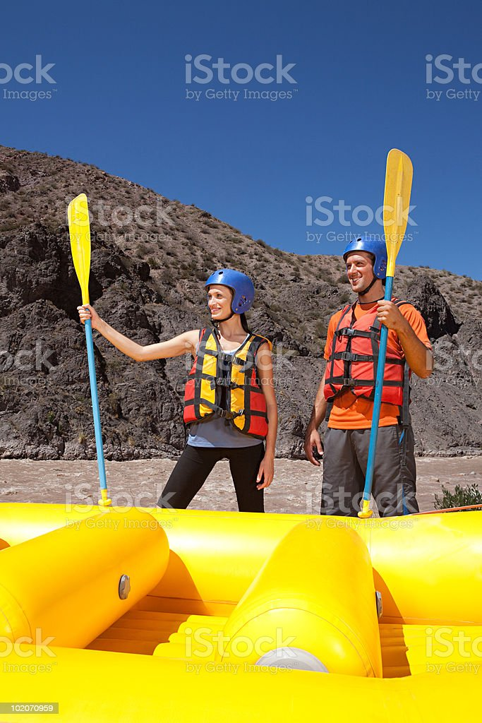 Man and woman ready for white water rafting royalty-free stock photo