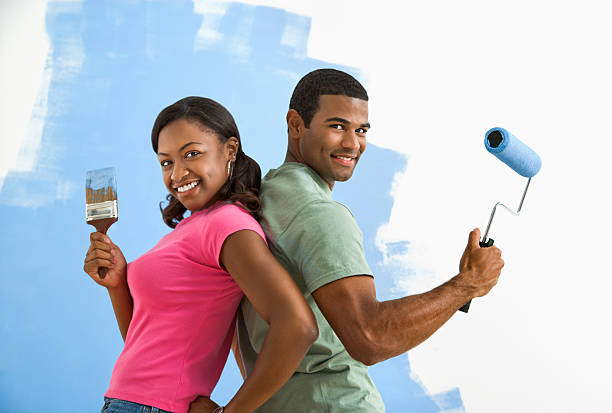 Man and woman ready to paint. stock photo