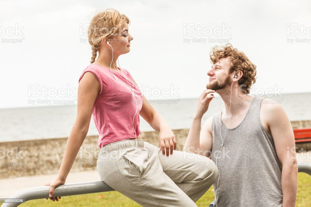 Man and woman relaxing listening to music. royalty-free stock photo