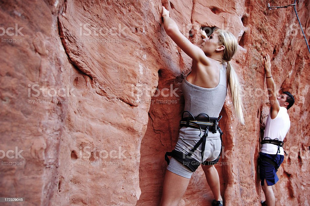 Man and woman rock climbers at St. George in Utah stock photo