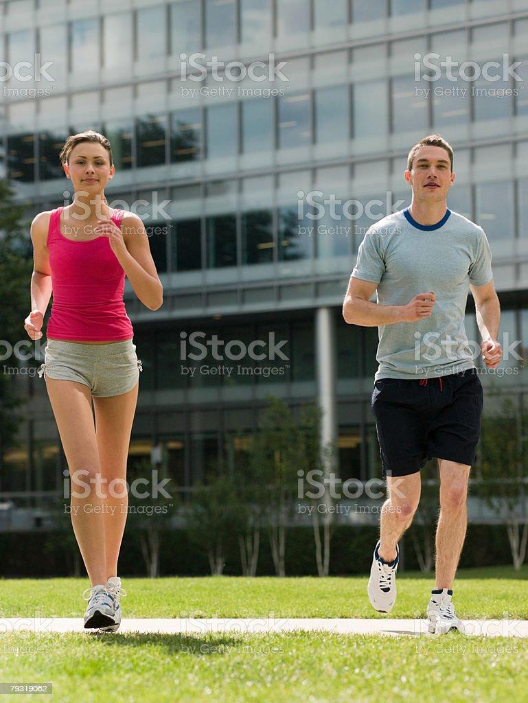 Man and woman running 免版稅 stock photo