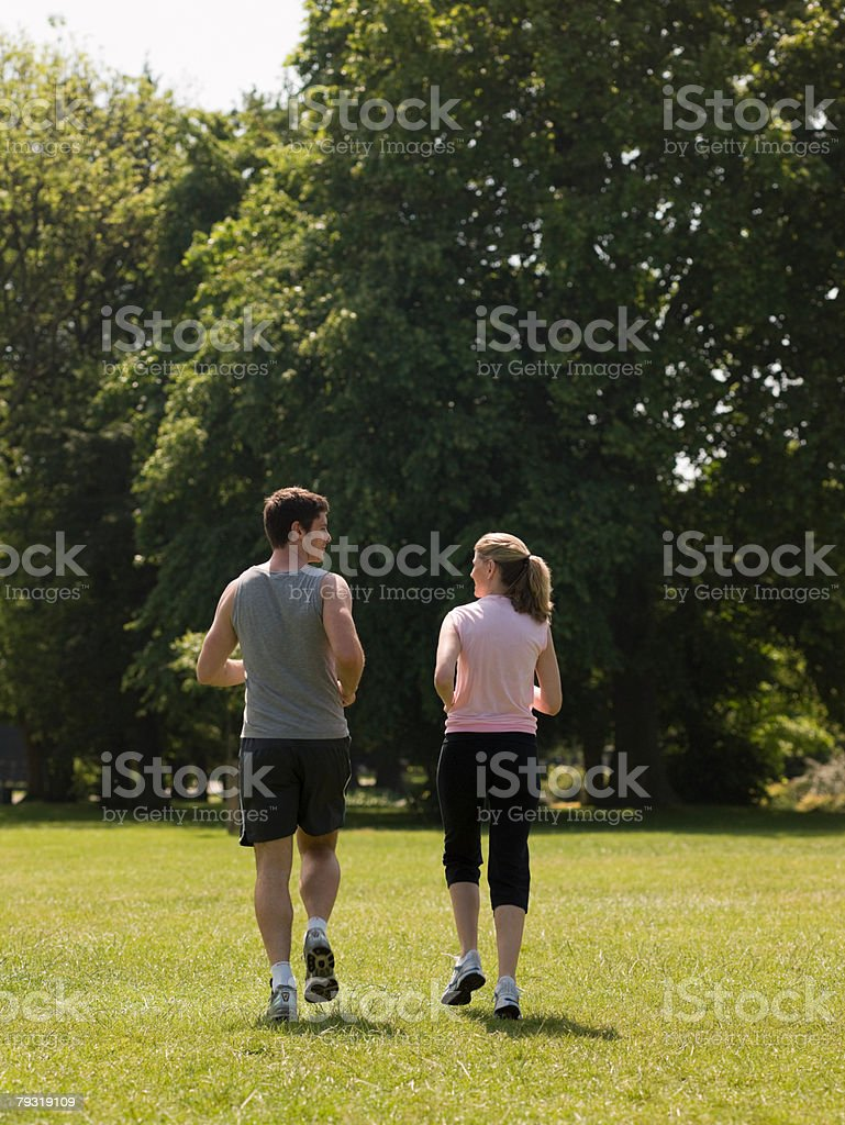 Man and woman running 免版稅 stock photo
