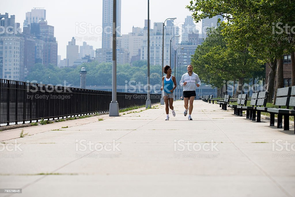 A man and woman running royalty-free 스톡 사진