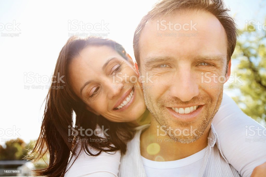 Man and woman sharing a loving moment outside royalty-free stock photo
