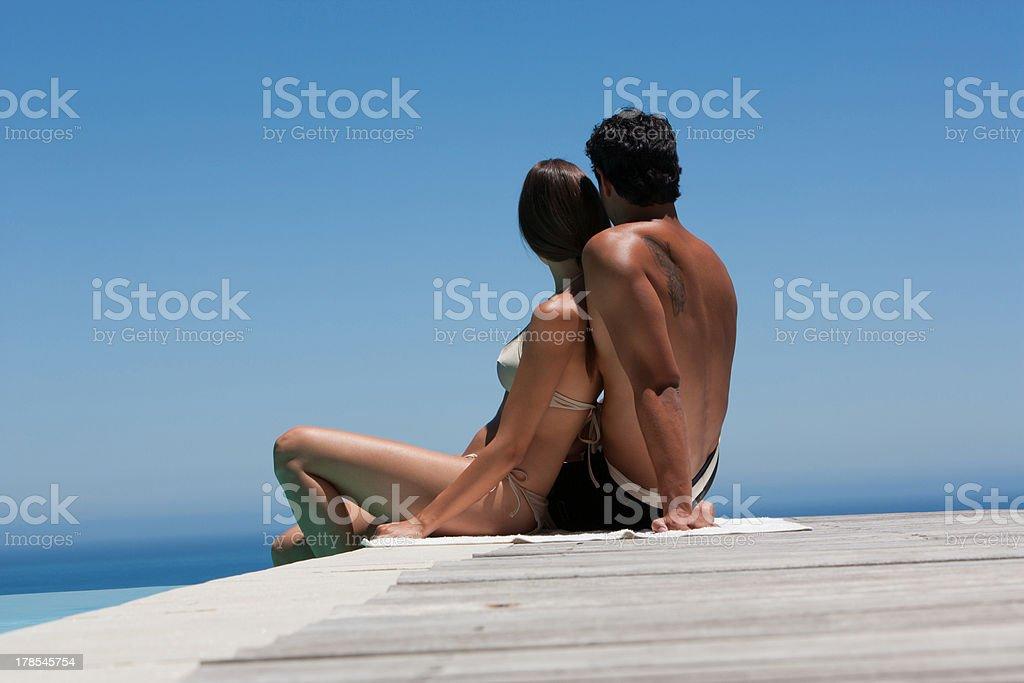 Man and woman sitting looking at sea  stock photo