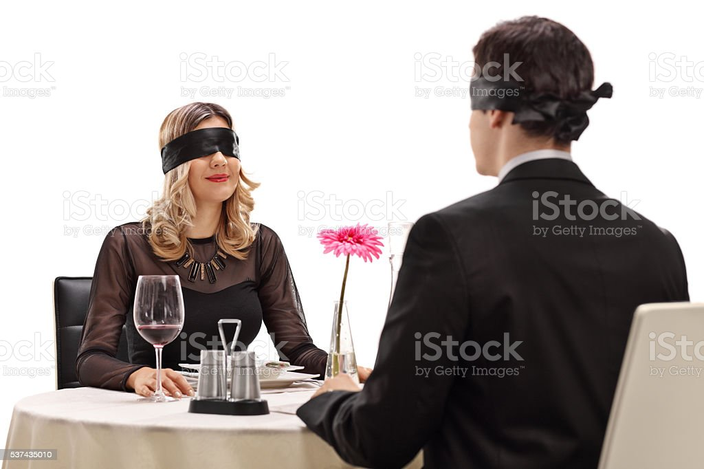 Man and woman sitting on a blind date stock photo