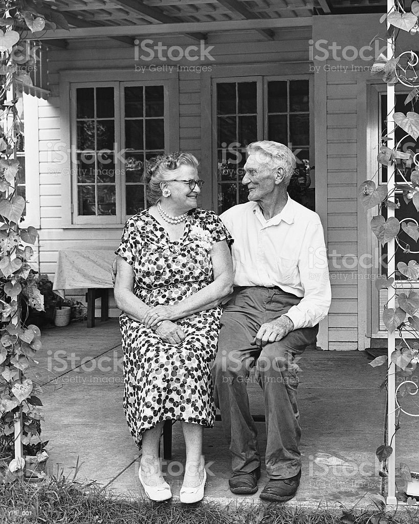 Man and woman sitting on porch royalty-free stock photo
