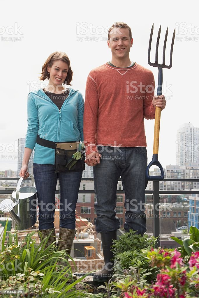 Man and woman standing on roof garden stock photo