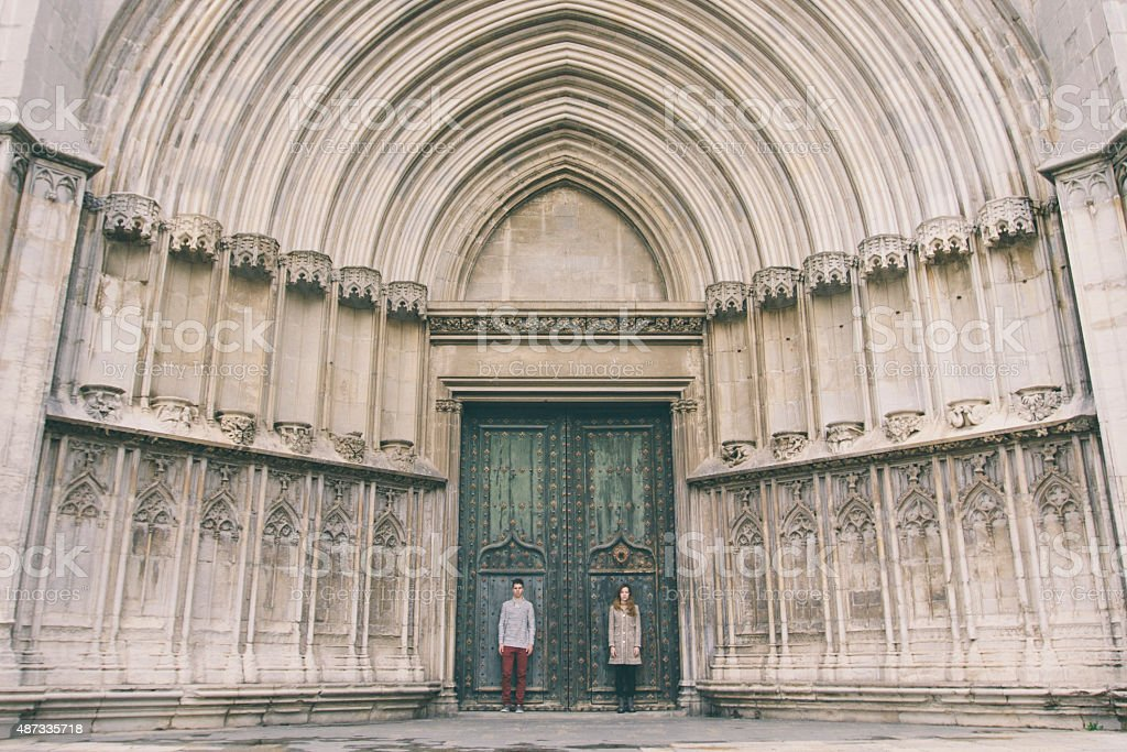 couple standing outside Girona Cathedral doors