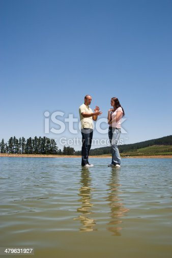 istock Man and woman standing  479631927