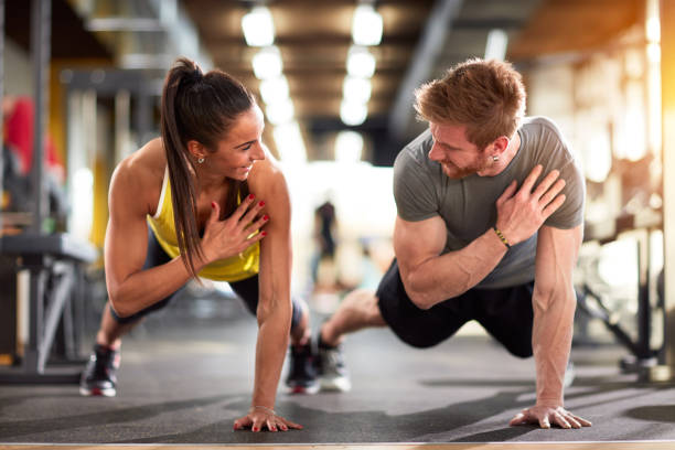 man and woman strengthen hands - woman muscular stock photos and pictures