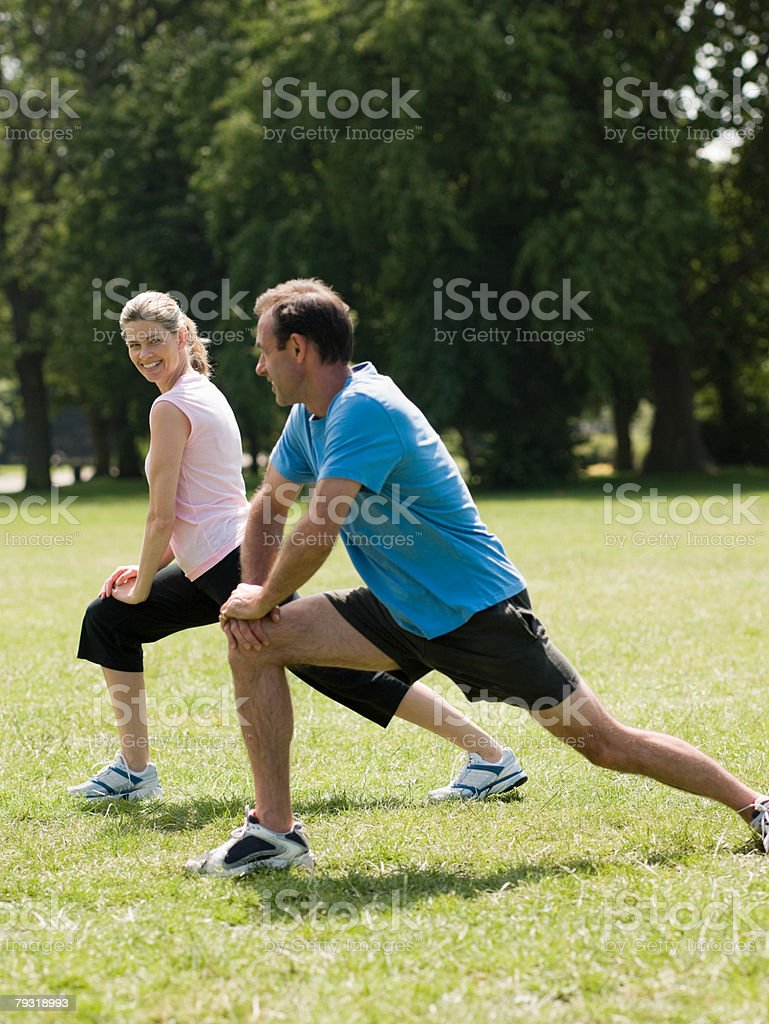 Man and woman stretching royalty-free stock photo
