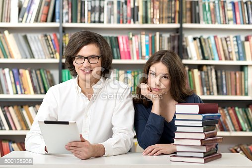istock man and woman studying and working in the library 500128938