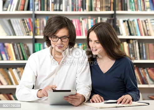 istock man and woman studying and working in the library 500129038