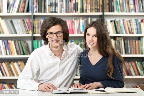 istock man and woman studying and working in the library 500129158