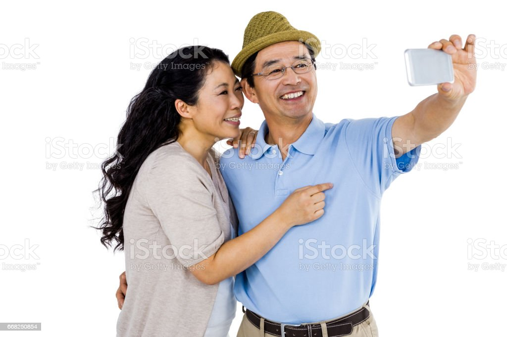 Man and woman taking a picture foto stock royalty-free