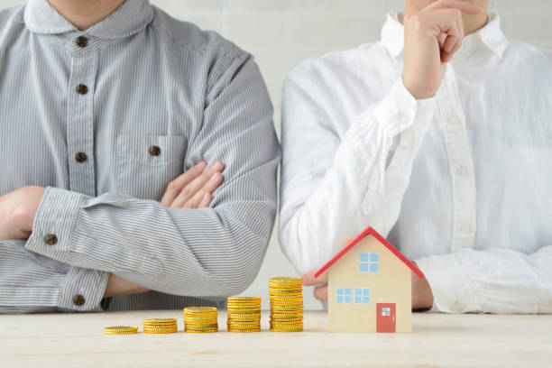 Man and woman talking about money and house problems stock photo