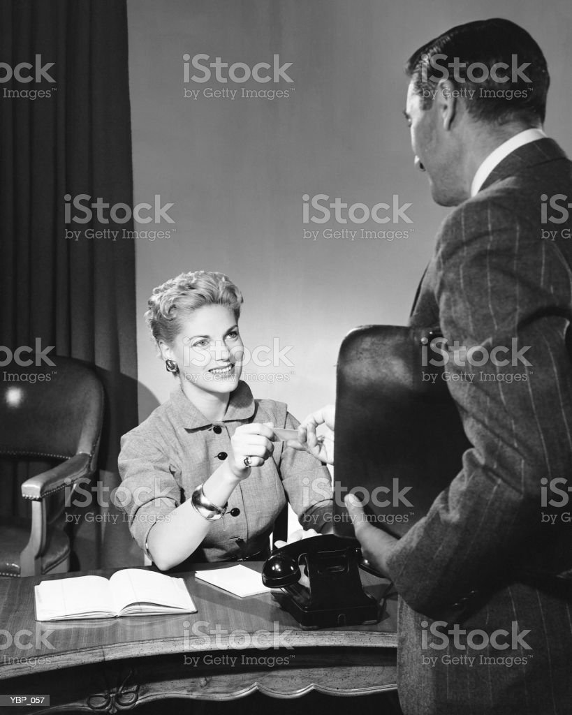 Man and woman talking royalty-free stock photo