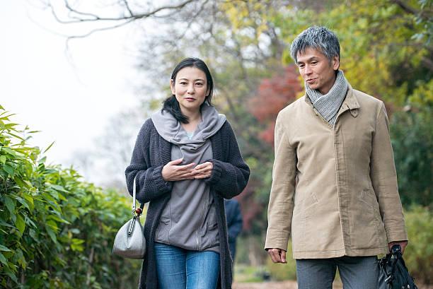 Man and woman talking while walking Man and woman talking while walking. age contrast stock pictures, royalty-free photos & images