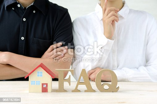 istock Man and woman thinking about housing 968782894