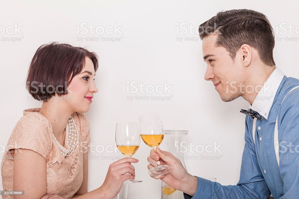 man and woman toasting with rose wine stock photo