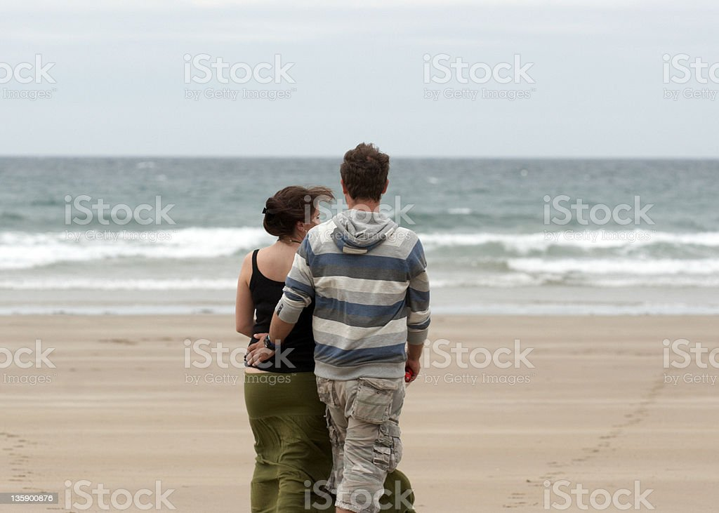 Man and woman together on the beach royalty-free stock photo