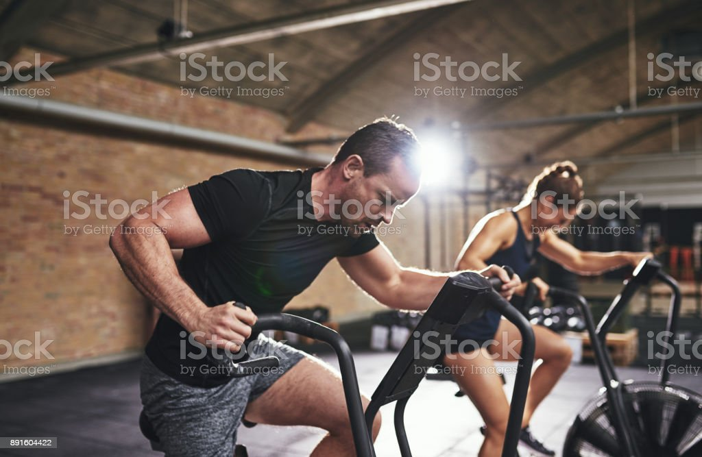 Man and woman training with gym equipment stock photo