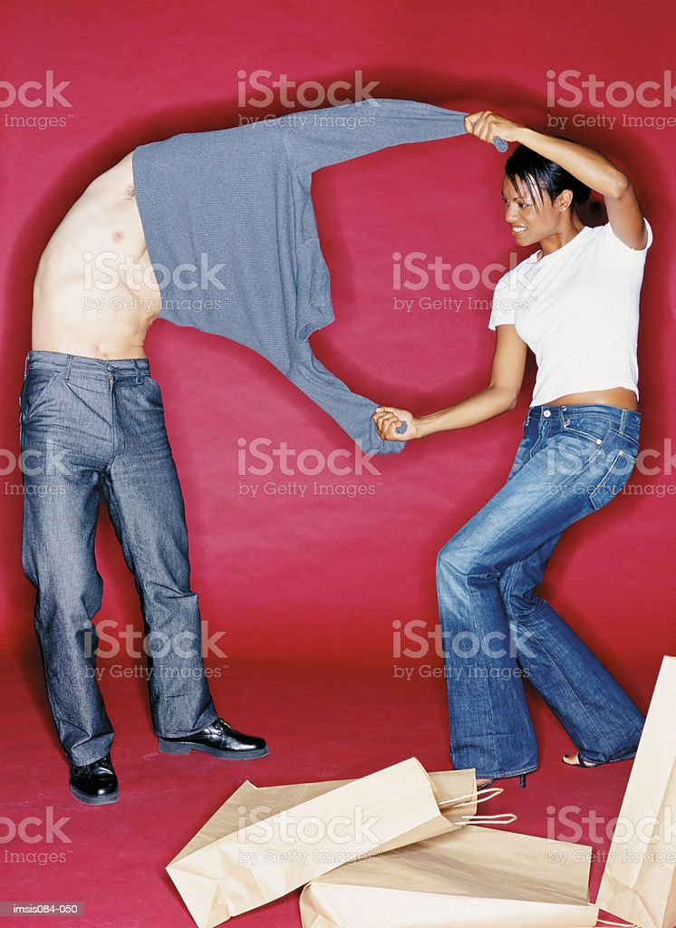 Man and woman trying on clothes royalty-free stock photo