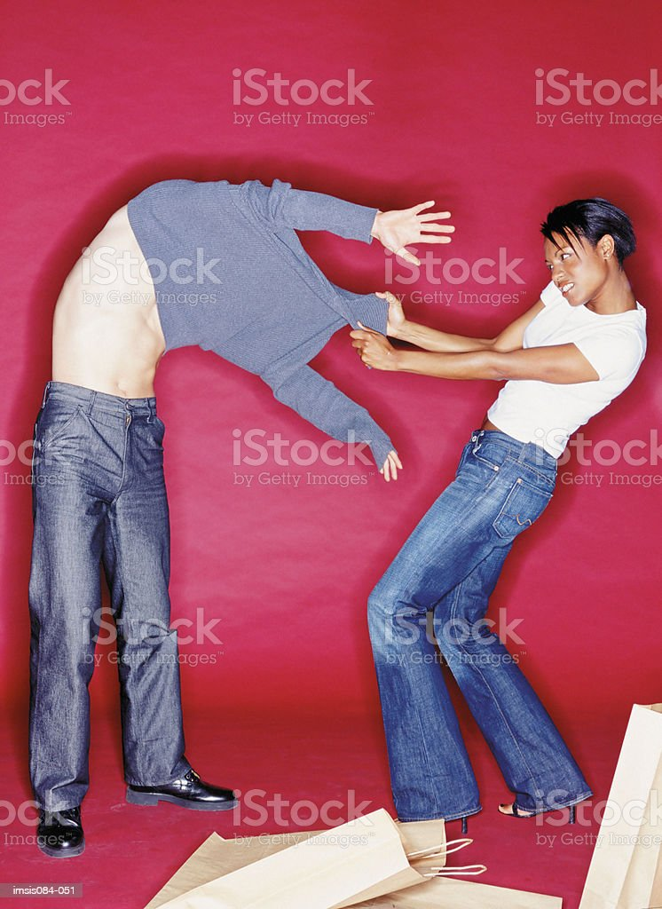 Man and woman trying on clothes foto royalty-free