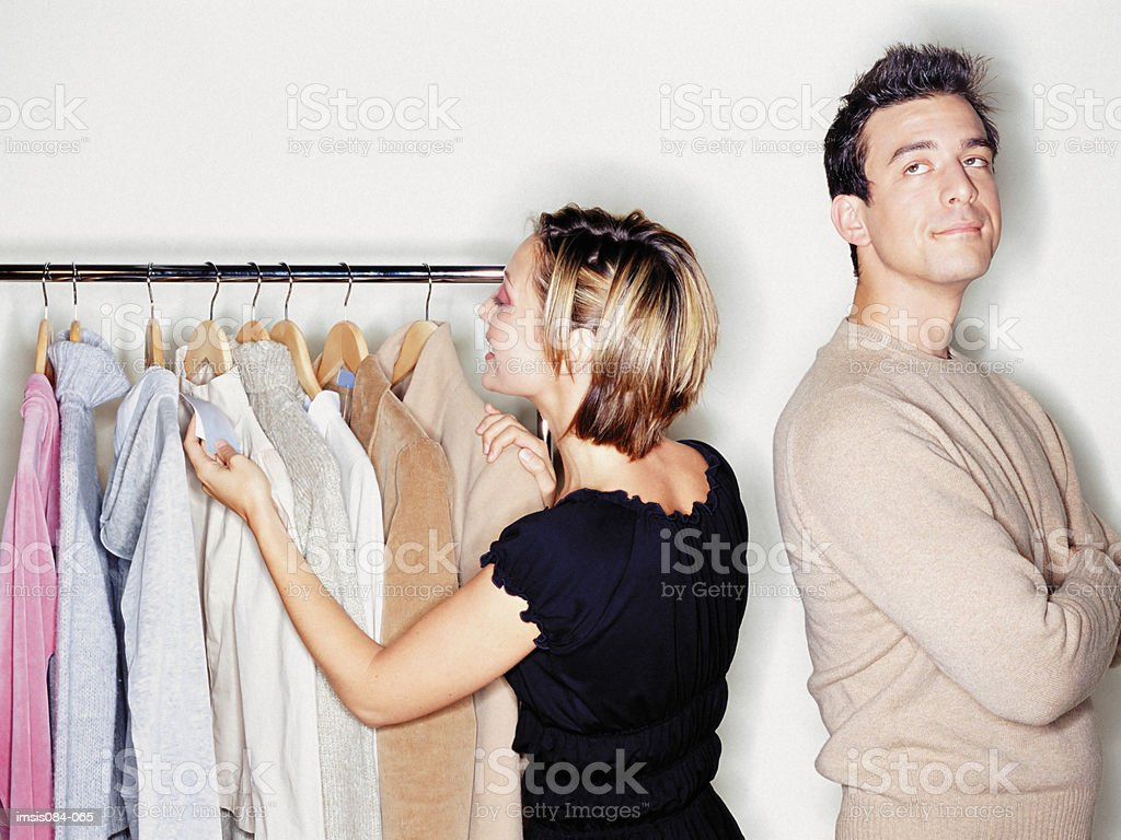 Man and woman trying on clothes royalty-free 스톡 사진