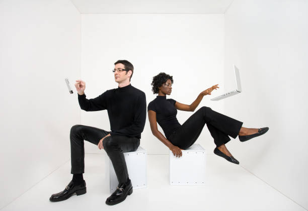 Man and woman using floating electronic devices stock photo