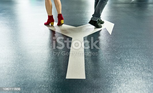 Man and woman walking on different directions.