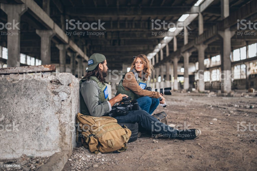 Man And Woman War Press Taking A Break In Abandoned Building Stock Photo Download Image Now Istock