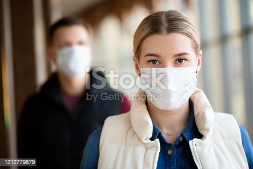Man and woman wearing protective mask against transmissible infectious diseases and as protection against the flu. New coronavirus 2019-nCoV from China