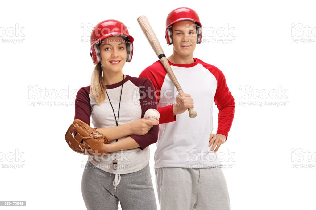 Man and woman with baseball equipment stock photo